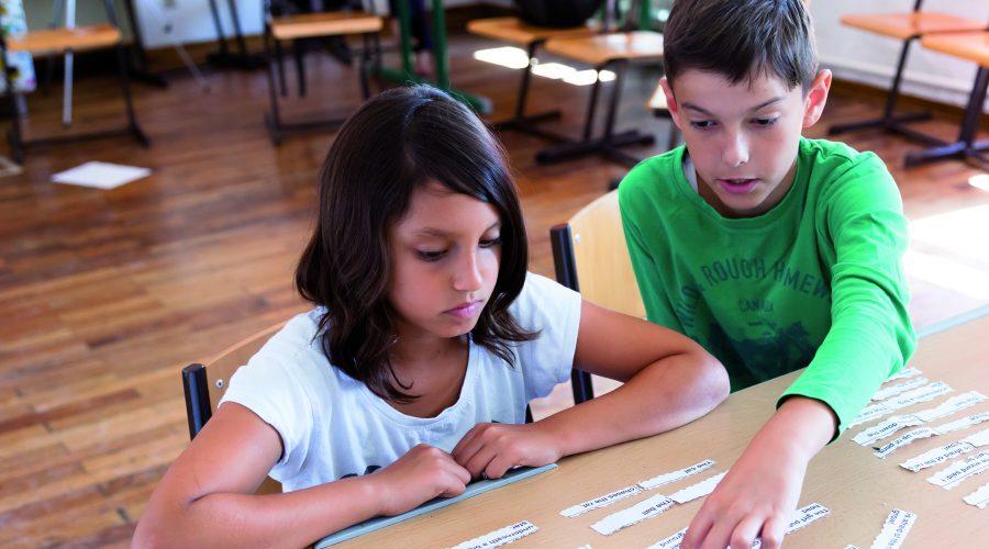 Symbolfoto von lernenden Kindern